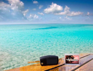 car-keys-and-keychain-on-wooden-table-overlooking-caribbean-
